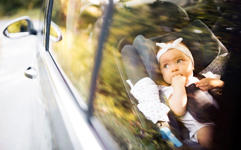baby-in-carseat-looking-out-car-window.jpg